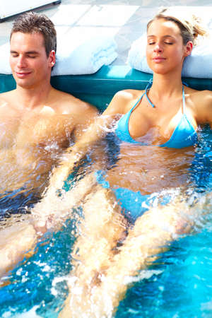 hot tub: Couple in hot tub.