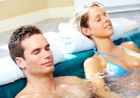 resting: Couple in jacuzzi.