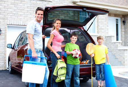 family vacation: Happy family and a family car. Stock Photo