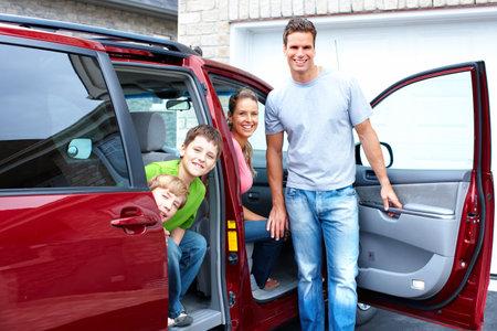 car inside: Happy family and a family car. Stock Photo