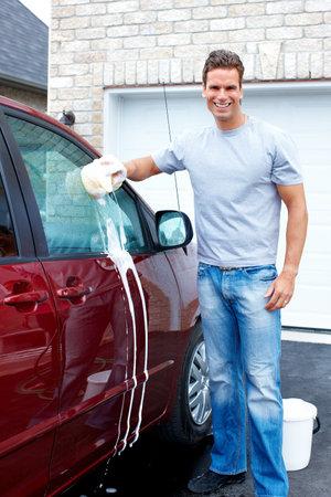 Happy man washing the car. photo
