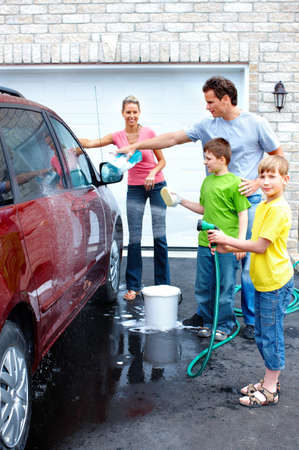 car wash: Happy family washing the family car.