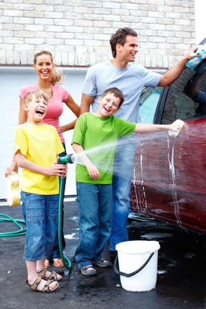 wash car: Happy family washing the family car.