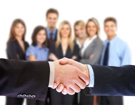 Handshake. Mensen uit het bedrijfsleven zitting. Stockfoto