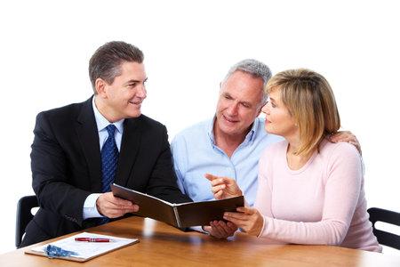 Senior couple with financial adviser. photo