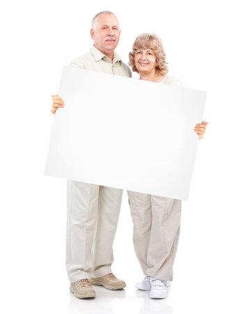 happy couple white background: Senior happy couple with placard.