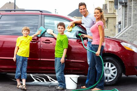Happy family washing the family car.