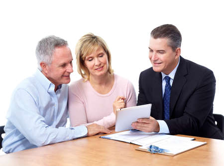 retirement: Senior couple with financial adviser.