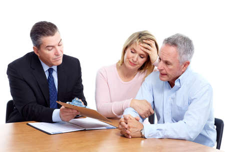 financial adviser: Senior couple with financial adviser.