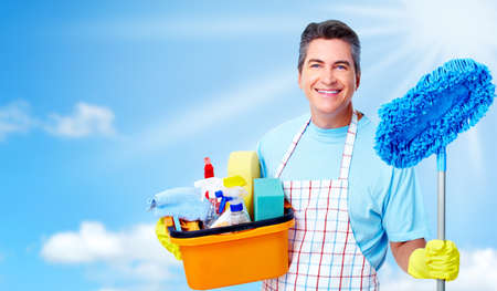 house cleaning: Professional cleaner man.