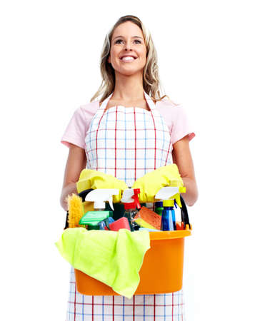 messy house: Young smiling cleaner woman. Stock Photo