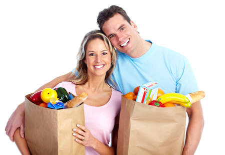 Couple with a grocery bag. Stock Photo - 12378896