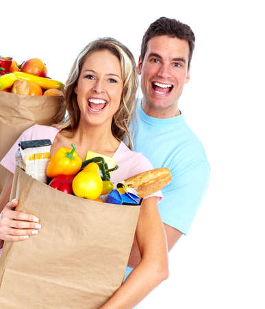 groceries shopping: Couple with a grocery bag.