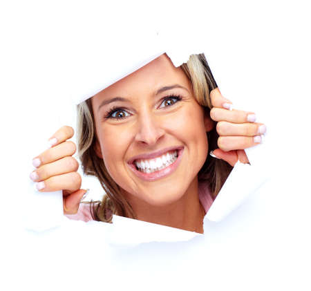 Happy young woman looking through a hole. Stock Photo
