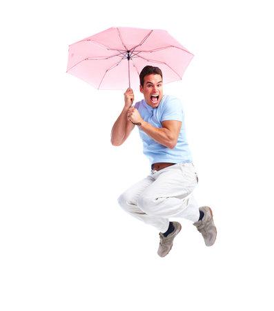 flying man: Flying happy man with umbrella. Stock Photo