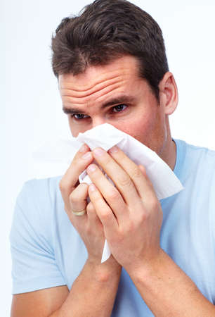 Sneezing man having cold. photo
