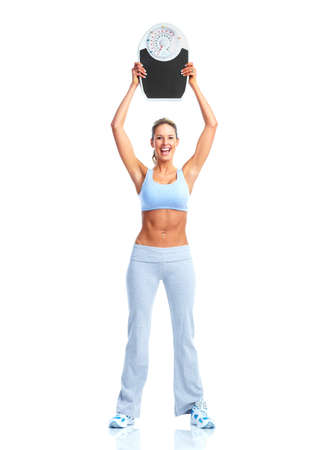 woman on scale: Fitness woman with a scales. Stock Photo
