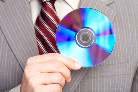 Businessman with a CD. Stock Photo