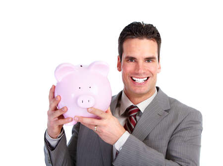 Businessman with a piggy bank. photo