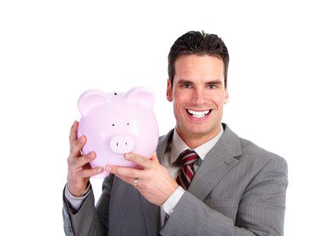 Businessman with a piggy bank. photo