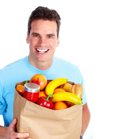 Young man with a grocery shopping bag. photo
