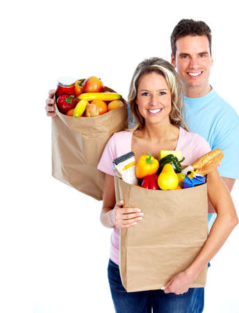 Young couple with a grocery shopping bag. photo