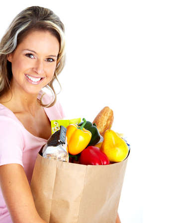 purchase: Young woman with a grocery shopping bag. Stock Photo