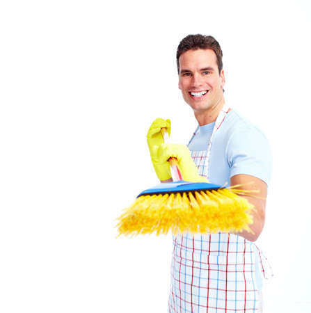 maid cleaning: Young smiling cleaner man. Stock Photo