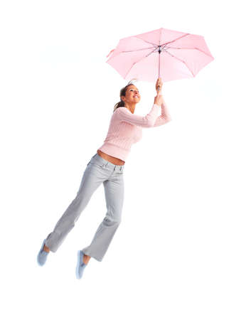 Woman flying with umbrella. photo