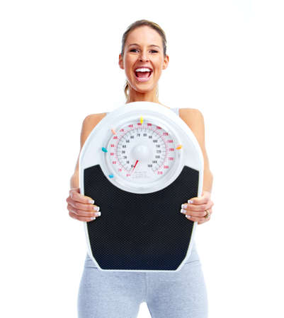 weighing: Happy Fitness woman with a scales.