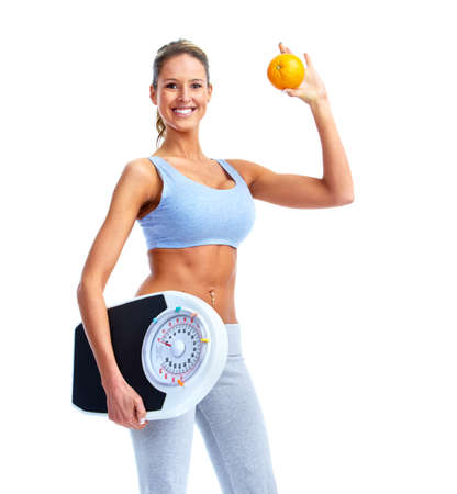 Happy Fitness woman with a scales. photo