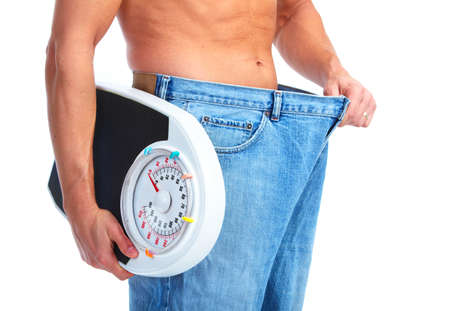Happy Fitness man with a scales.