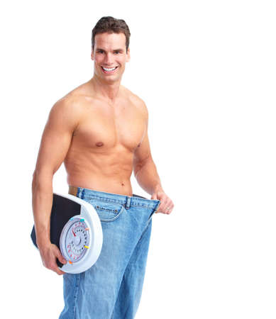 weight loss success: Happy Fitness man with a scales.