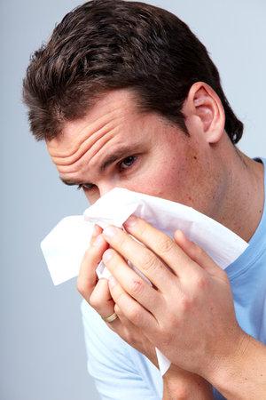 rheum: Sneezing man having cold. Stock Photo