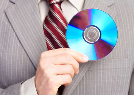 blu: Businessman with a CD. Stock Photo