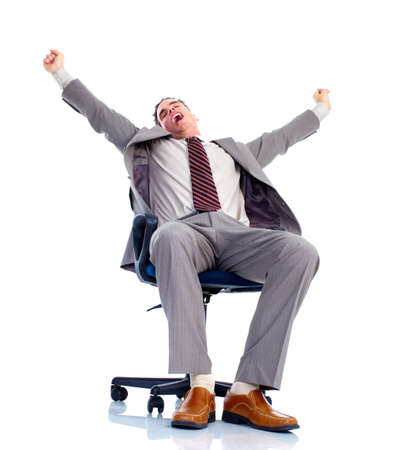 man in chair: Relaxing handsome businessman. Stock Photo