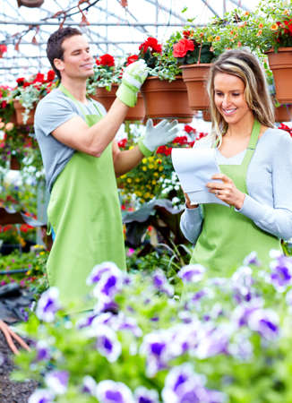 Florists couple working at flower shop. photo