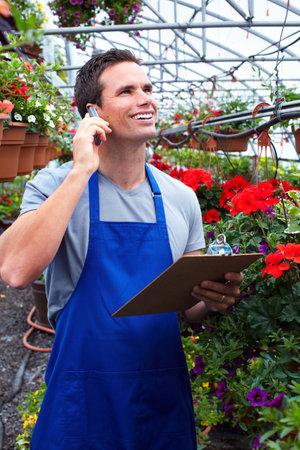 farm worker: Florist man working with flowers.