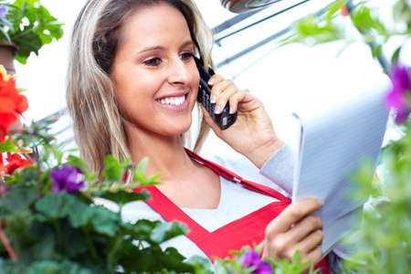 Florist woman working at flower shop. Stock Photo