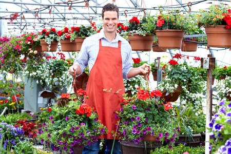 Florist man working with flowers. photo