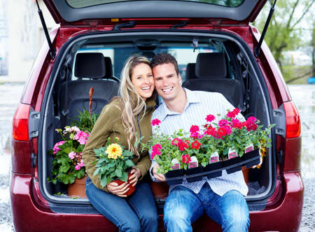 Happy couple with flowers. photo