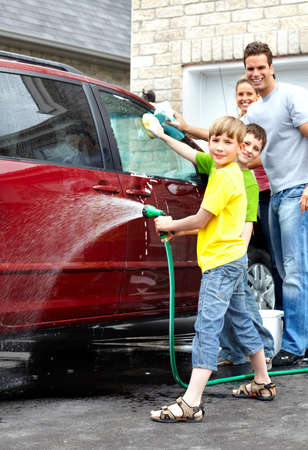 Happy family washing the family car. photo