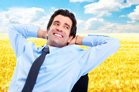 Happy relaxing businessman  photo