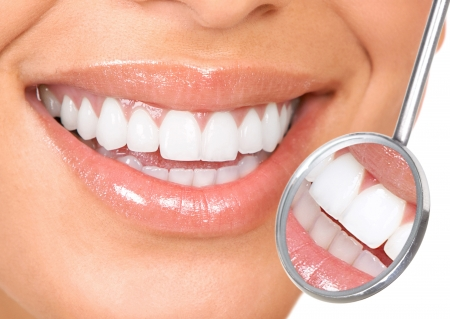 woman mirror: teeth Stock Photo