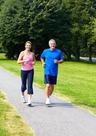 Seniors couple jogging  photo
