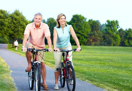 Senior couple cycling  Stock Photo