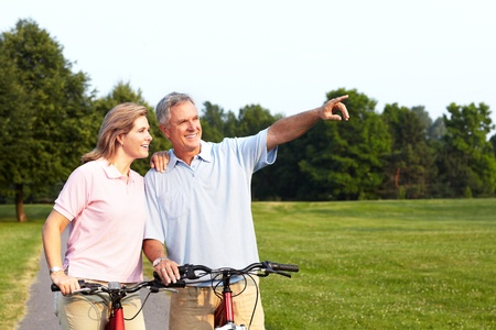 Senior couple cycling  photo