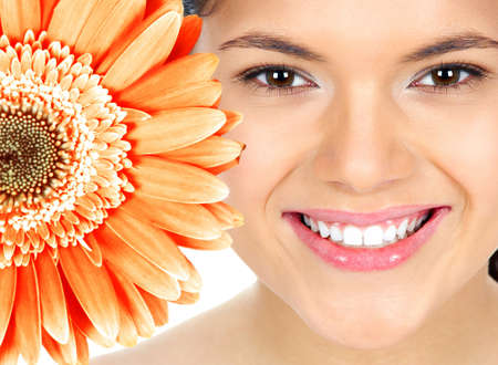 smile close up: Beautiful woman smile with flower  Stock Photo
