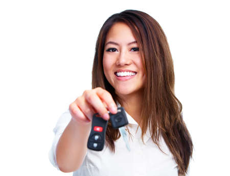 Asian woman with car key