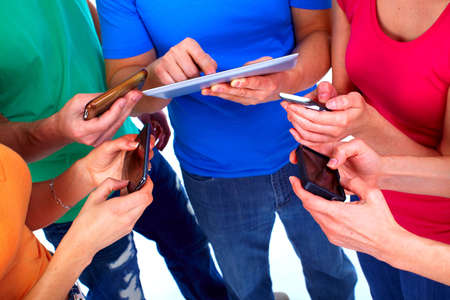Human hands with tablet and smartphone Stock Photo - 13541700